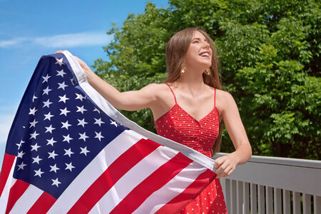 day dream: Woman American Flag � 4th of July Stock Photo