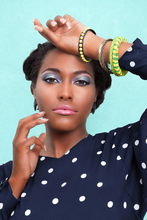 African American woman wearing pink lipstick  makeup and jewelry photo