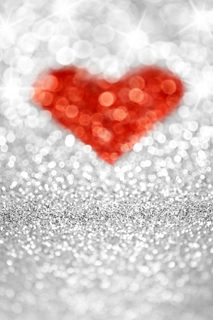 Abstract sparkly glitter heart background photo