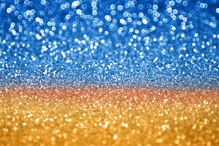 El oro azul de la chispa del brillo de fondo