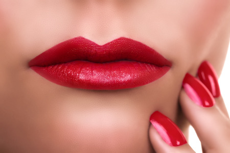 lips close up: Woman with red lips lipstick and manicure