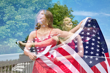 Abstract creative double exposure of photos of patriotic woman waving the American Flag for July 4th Stock Photo