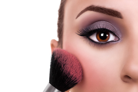 make up eyes: Beautiful woman make up and blush brush. Makeup.