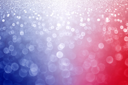 Abstract patriotic red white and blue glitter sparkle background photo