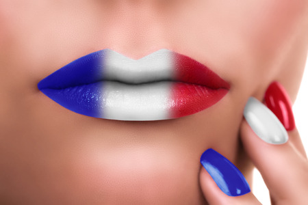 feast day: Woman French Flag lipstick kiss and manicure Stock Photo