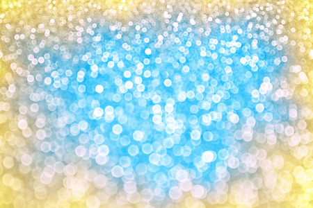 Abstract blue yellow sparkle bokeh background