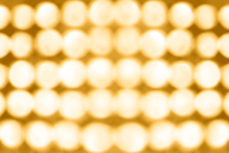 golden texture: Abstract stage lights bokeh party background invitation Stock Photo