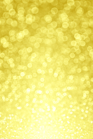 Abstract yellow glitter sparkle bokeh background
