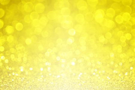 Gele glitter fonkelingsachtergrond