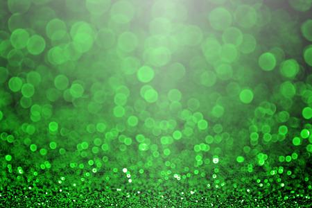 Green Christmas glitter sparkle or St Patrick s Day Background party invitation Foto de archivo
