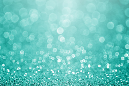 december: Teal turquoise green glitter sparkle background party invite Stock Photo