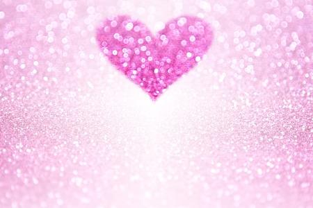 Pink glitter sparkle heart background for Valentine's Day or birthday party invite Foto de archivo