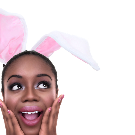 girl party: African American black woman dressed in Spring Easter bunny ears or Halloween rabbit costume Stock Photo