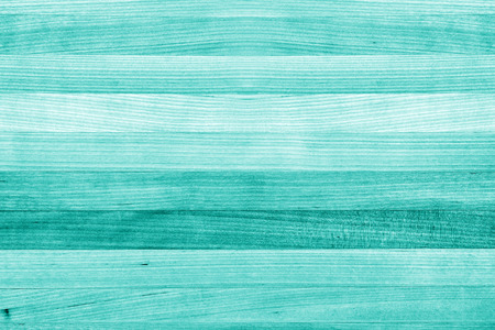 Teal or turquoise green paint wood background texture