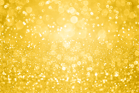 Gold glitter sparkle background or golden confetti party invite