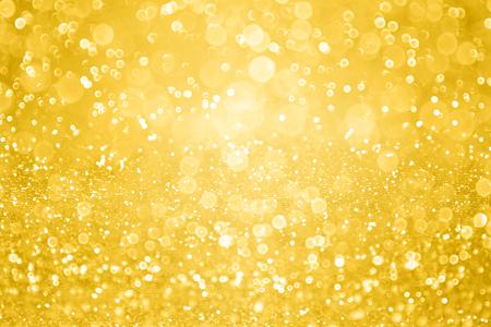 Gold glitter sparkle background or golden confetti party invite
