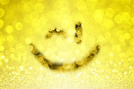 flirty: Abstract yellow emoji smiley face wink or winking emoticon sparkle background
