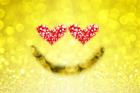 lovestruck: Abstract yellow emoji emoticon smiley face background with sparkle heart eyes for love Stock Photo