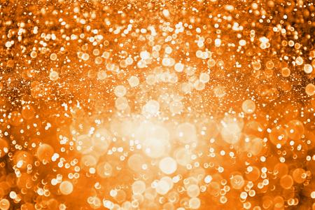 Abstract dark orange glitter sparkle background or party invite for Halloween trick or treat, november Thanksgiving or happy birthday texture Standard-Bild