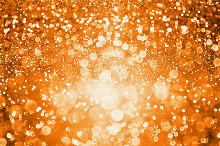 Abstract dark orange glitter sparkle background or party invite for Halloween trick or treat, november Thanksgiving or happy birthday texture Stock Photo