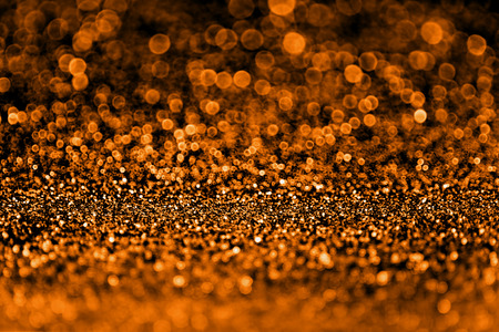 Abstract spooky dark orange and black glitter sparkle fright night background for Halloween trick or treat party invite or flyer 版權商用圖片