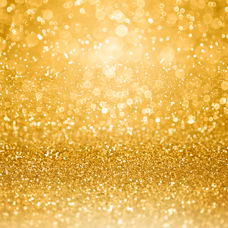 Abstract glamorous gold glitter sparkle confetti background or glitzy glam luxury golden color party invitation for birthday, anniversary, wedding, Christmas or new years eve Stock Photo
