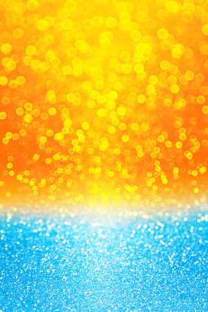 Abstract summer tropical blue and yellow sunset or sunrise sparkle party invite or sunny holiday vacation travel background over sea, lake, ocean, beach, pool or water bubbles pattern with sun texture Stock Photo