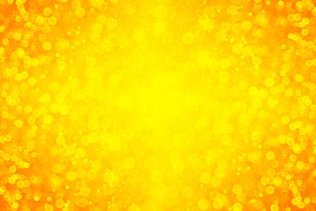 Abstract yellow orange glitter sparkle bokeh background or party invite for happy birthday border, Autumn frame, Halloween burst explosion, Thanksgiving or wedding