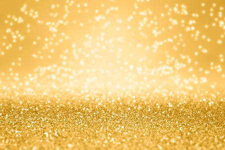 Elegant gold glitter sparkle confetti background for golden happy birthday party invite, 50th anniversary, New Year's Eve champagne backdrop, glitzy falling diamonds, Christmas or wedding luxury sparkly pattern