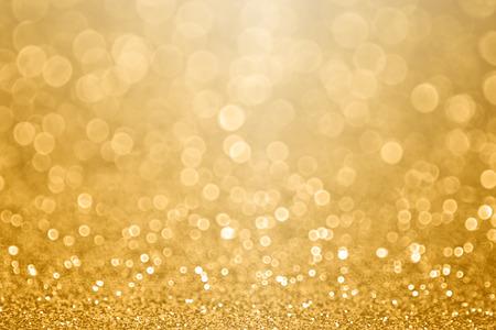 抽象的な金のきらめきは、50結婚記念日、大晦日、幸せな誕生日、落下コインやクリスマスのお祝いのための、黄金のテクスチャパーティーを招待し
