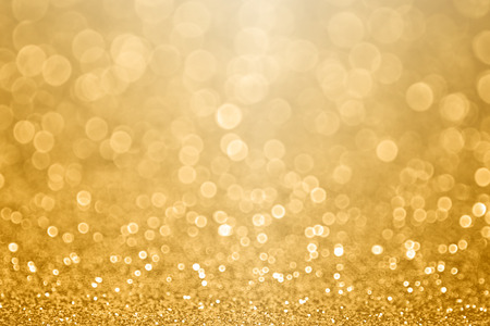 Abstract gold glitter sparkle confetti background or golden texture party invite for 50 wedding anniversary, new year's eve, happy birthday, falling coins or Christmas celebration