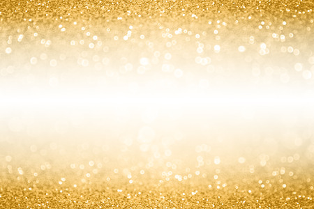 Fancy gold glitter sparkle confetti background for golden happy birthday party invite, 50th wedding anniversary banner, sequin glitz border, Christmas ad or New Year Eve champagne color white space Foto de archivo