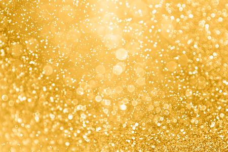 Elegant gold glitter sparkle confetti background for golden happy birthday party invite