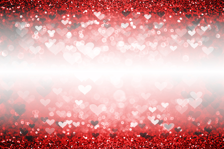 Abstract romantic red glitter sparkle confetti background or beautiful party invite with hearts for happy birthday card, Valentine's Day sale, wedding texture or love pattern with white space 版權商用圖片