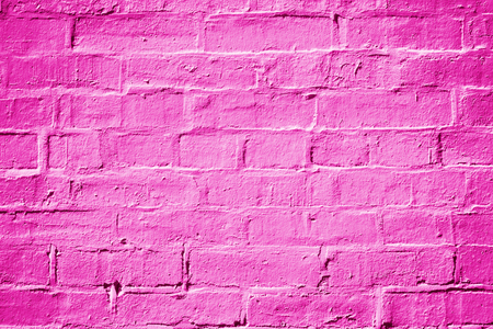 Abstract hot pink, magenta and fuchsia painted brick wall texture background or pattern