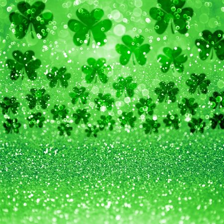 Abstract green glitter sparkle confetti background or party invite with lucky Irish Shamrock clovers for St Patricks Day sale flyer, Saint Patty celebration, card, Spring texture, luck pattern or poster