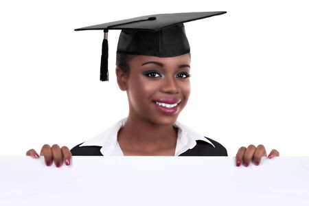 Beautiful intelligent educated ethnic African American black graduate woman holding sign or banner for graduation and wearing mortar board. Student education scholarship concept 版權商用圖片 - 141410542