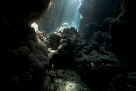 Underwater cave and sunrays in the Red Sea Stock Photo
