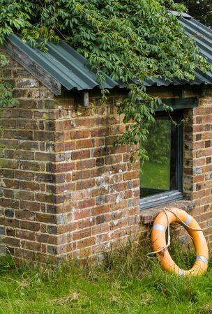 Brick shed with Lifebuoy photo