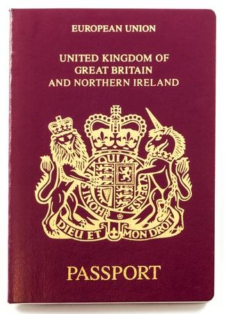 passport: Pasaporte brit�nico aislado en el fondo blanco