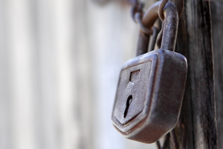 Close-up of lock and chains on old door Stock Photo - 61936544