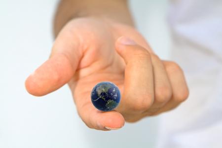 Hand holding earth on fingertip Stok Fotoğraf