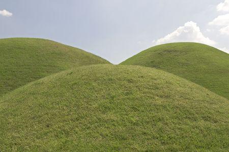 Three Grassy hills in Tumuli Park in South korea photo