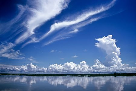 Dramatic sky over a lake in Cambodia Stock Photo