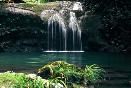 Small waterfall pours into a natural basin, Guatemala