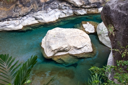 Marble rock in a clear river in the Taroko gorge, Taiwan