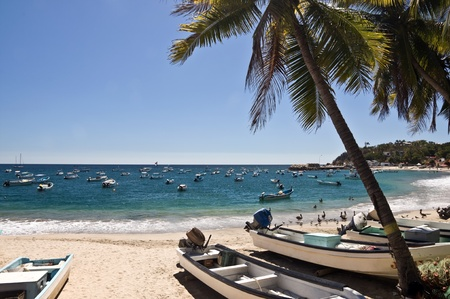 Boats on the beach of Puerto Escandido, Mexico Stock Photo