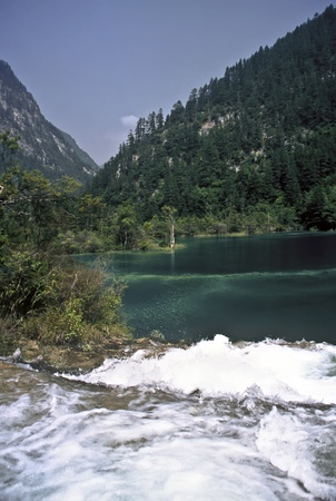 spay: Waterfall and lake in the Jiuzhaigou National Park, China
