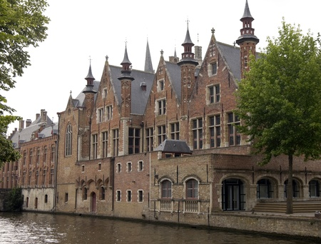 brugge: Canal in Bruges lined by old houses, Belgium Stock Photo
