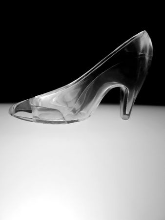 cinderella shoes: an illuminated glass slipper in Black and White Stock Photo